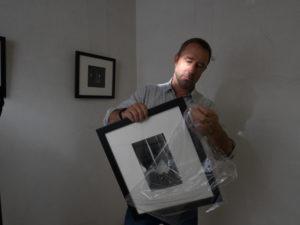 Michael Glenister unpacking work